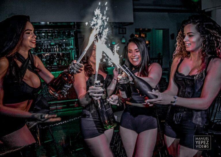 Bottle girls lighting up champagne for Hispanic Heritage Month
